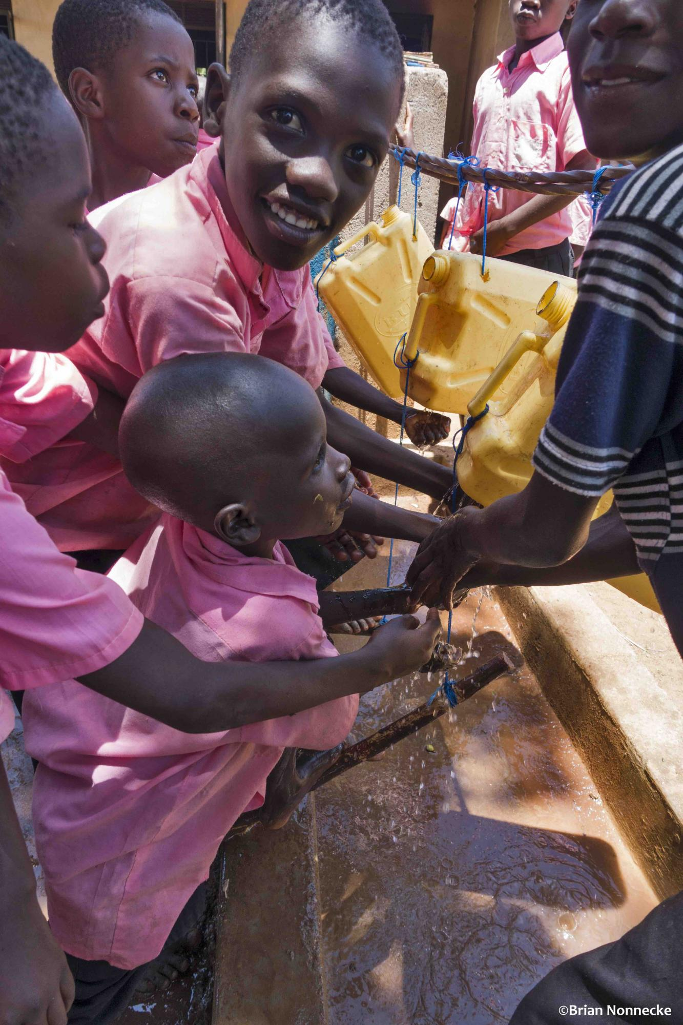 Ugandan children washing hands.